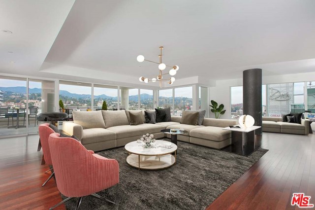 An Exciting Opportunity to Own A Large, Prime Corner Penthouse at The W Residences Hollywood. This spacious 3 Bedroom Home has near 3300 SF and is A Piece of Real Estate Not To Be Missed. Not only does this Penthouse have Jaw Dropping Views of the Hollywood Hills, The Famous Hollywood Sign & Capitol Records, But It has Not One, But Two Large Balconies Totaling Approximately 1000 Square Feet.  In addition, this home comes with 3 parking spaces where you have the choice to use valet service or self park.  Other W Residence Amenities Include 24 Hour Security, The Best Rooftop Pool Deck in LA at 1/2 Acre, Dog Park & Sweat Fitness Center, Screening Room and so much more. 1 pet allowed per residence. First 2 photos are virtually staged.