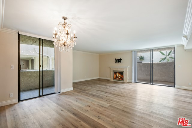 Newly renovated condo in the sought after Hollywood Hills Foothills! Beautifully updated & renovated extra large 1 bd, 2 ba courtyard facing, located in the center of the complex away from the hustle and bustle of the city. Only 1 common wall & direct access to the pool from one of the multiple patios, this spacious unit is in move-in ready & has a new designer kitchen, stainless steel appliances, formal dining area, fireplace, huge bedroom w/ 2 large closets and en suite bath, laundry in unit (new washer), 2 private patios, new hardwood floors throughout, new paint, new A/C, new electrical, & many new fixtures. Secured building entry, gated garage, 2 side by side parking spaces & views when pulling in, two recreation rooms w a pool table, a dog run, sparkling large pool & separate spa area. Excellent location just minutes from Gelsons, Franklin Village, Birds, the Pantages, Hollywood & Highland, the Hollywood Bowl, & Beachwood Canyon to name a few. This one has it all & is a must see!