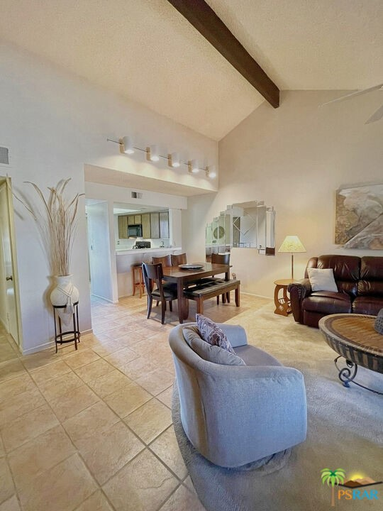 Great opportunity to own a 2 bedroom / 2 bathroom turnkey condo in the Summer Breeze community. Please, make certain to watch the Virtual Tour here in the MLS. The Summer Breeze community is adjacent to JFK Hospital, as well as conveniently located close to outstanding restaurants, shopping and golf. The condo is approximately 1041 sq ft with high sloped beam ceilings in the living room and primary bedroom. The primary bedroom and kitchen sliders look out to one of the three community pools and spas! Includes extra exterior storage and outfitted tool closet. One assigned covered carport space. Other amenities include 3 tennis/sports courts, basketball court, clubhouse, maintenance, lighting, onsite management and gated community.