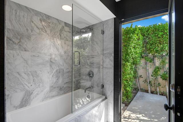 GUEST BATHROOM TUB AND SHOWER TO SIDE YA
