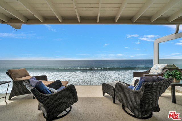 Rarely offered tenancy-in-common unit on Malibu Road in a special location - the last building on the street. Enjoy panoramic ocean views and the sound of the waves from this upper unit on one of Malibu's most coveted roads. With large expanses of sandy beach next to the building and direct steps from the courtyard to the sand in front, there is no better place to spend the summer. The unit itself features sliding glass doors that open from the living room with gas fireplace to a large balcony for a seamless flow. Enjoy the ocean view from the kitchen and dining area with built-in seating. The bedroom is tucked away and private with a built in office area, large closet and stacked washer and dryer. There is a one car garage with more additional space for another car behind the garage. The building has a common area courtyard and community laundry room as well. So special!