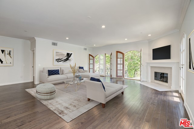 Newly-renovated corner unit in the heart of Beverly Hills! This 3 Bed + 4 Bath is bright and spacious, with French doors overlooking serene treetops, new hardwood floors throughout, fireplace, plus new kitchen with Calacatta quartz countertops and stainless steel appliances. Each bedroom enjoys its own en-suite bathroom, and the master bath includes a spa stub. Enjoy the newly-renovated rooftop's panoramic mountaintop views! Also comes with three side-by-side parking spaces and extra walk-in storage closet.