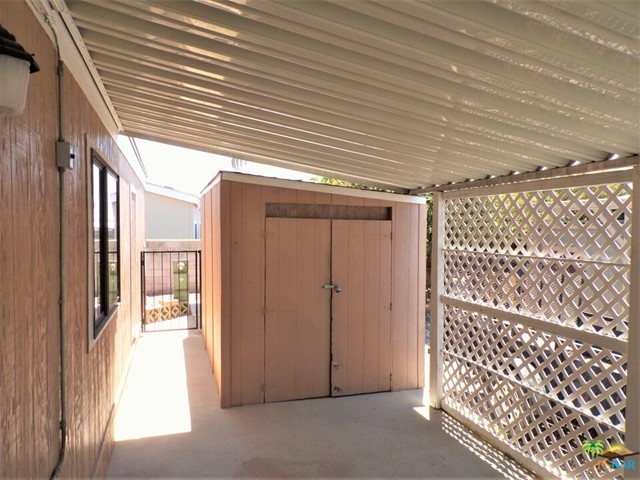 Ample Two Car Parking Under e Carport Includes A Large Shed