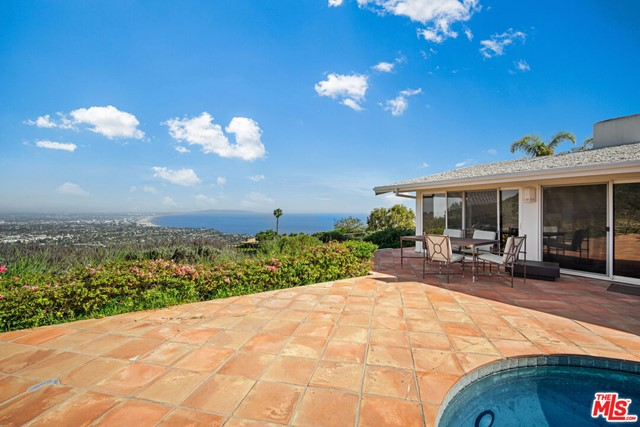 This stunning Upper Lachman home located in the extremely desirable Marquez Knolls is perched on a coveted street with an expansive 16,600 sqft lot. Experience panoramic ocean views From Catalina, Palos Verdes and the Queen's Necklace to Downtown LA. Bring your dreams to life by creating a stunning home, indoor/outdoor living space and pool on this pristine piece of land-there are endless possibilities! As the lighting changes throughout the day, enjoy the striking display of sunshine and spectacular sunsets. The current home features 3 bedrooms and 2 bathrooms with living spaces that overlook the breathtaking views. Close proximity to all the Palisades has to offer, including the luxury conveniences of the new Palisades Village and a short drive to the ocean