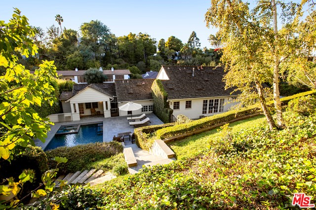 This stunning and traditional home off Tower Road in Beverly Hills offers lush landscaped grounds, a private yard, incredible pool and spa, BBQ, as well as a fabulous 1 BR & 1BA pool/guest house with separate entrance. Set back from the street with a circular driveway, this house is equipped with a large living room featuring hardwood floors, beamed ceilings, and an original huge wood-burning fireplace. There is a cozy den off of the living room, a powder room, large formal dining room, granite eat-in kitchen and maids/office complete first floor. Also find 3 additional bedrooms, each with their own bathroom. The impeccable master bedroom is garden side with glamorous French doors. Dont miss out on this one of a kind opportunity, just minutes from all of the shopping and schools Beverly Hills has to offer. Call for a private showing.