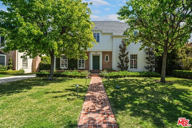 Located in coveted southwest Beverly Hills, this elegantly remodeled traditional 4 (or 5) bedroom home was designed by renowned architect, Richard Manion.  Warmth and beauty greet you as you enter into the formal entry with a beautiful staircase.  The large formal living room with a fireplace has French doors that open to a bricked in covered patio with a fireplace and grassy yard.  The kitchen boasts of a center island with a sink, tile floors, quartzite countertops, stainless steel appliances by Wolf & Subzero and an abundance of storage. The spacious formal dining room, family/breakfast room with a fireplace, powder room, maid's room with an en suite bathroom and service porch complete the main floor. Upstairs consists of the master bedroom with a walk in closet and a bonus area that is perfect for a home office, yoga, or sitting area.  There are 2 additional bedrooms each w/built in desks.  All bedrooms feature an en suite bathroom with tile floors & quartzite countertops & showers. The large permitted basement, complete with windows, a wet bar, closet & 3/4 bathroom can be an additional bedroom, play room or gym, etc. Additional features include hardwood floors, a/c, LED recessed lights, black out shades, water filter, security & more. The oversized 2 car garage has built in storage and a sink.  This home is close to all that BH has to offer.