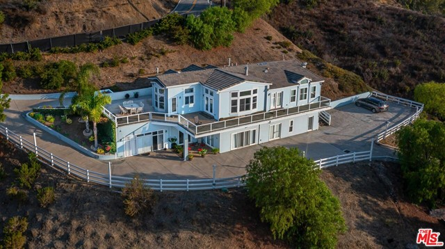 Luxury Live Auction! Bidding to start from $2,000,000! 4 Acres in Malibu! Envision yourself sitting atop the rolling hills of Malibu at this exceptional and unique gated home with complete privacy and explosive, unobstructed, panoramic mountain views. Not many homes can compare to the serene peace and quiet one feels while living at one of the most significant & prestigious residential compounds in California. Constructed in 2002 on nearly 4 acres, this 5,066 sq. ft. home with 5 bedrooms, 4 bath, offers sensational high-quality finishes throughout, a spectacular resort-style outdoor sitting area, horse pen, while leaving plenty of extra room to add a detached garage, a huge guest house, pool & spa, tennis court, basketball/sports court, playground, horse stalls and much more. Many people wish to get away from it all but cant be too far from their jobs in the city. This home offers the luxury of privacy, and the convenience of access to beaches and the highway in just a few minutes.