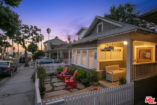 Remarkable opportunity to live only a few houses from the beach on one of the most coveted streets in Santa Monica. Highly desirable enclave boasts quiet tree-lined streets w/homes rarely hitting the market & within steps of local shops, restaurants, entertainment, parks, bike & walking paths. Be greeted by a charming white picket fence & front patio for morning coffee while relishing the ocean sunrises. Inviting great room accented by vaulted ceilings w/wood beam detailing & endless windows for floods of light. Open kitchen w/ss appliances, double oven, island, wine storage & flows to the dining. Tranquil master w/built-ins, office space, soaring ceiling, walk-in closet & lux bath w/glass shower & dual vanities. Private & peaceful yard w/ample space for al fresco living enveloped by lush greenery. Includes extensive/efficient storage space, outdoor shower, & bonus space for office, art studio, etc. Take advantage of this once in a lifetime chance for an enchanting Santa Monica haven.