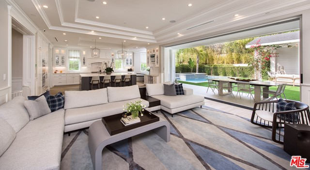 Located in the heart of Beverlywood, this reimagined Traditional estate by famed designer Lonni Paul checks off every detail from even the most selective of buyers. Immersed with natural light as you enter, a grand 2-story living area opening out to an outdoor patio. A custom milled formal dining room envelopes you with coved ceilings and hand woven wallpaper that sets the tone for a palette of finishes that pleases a true critiques eye.  An open floor plan leads to a chef's kitchen with an oversized island, butlers pantry, and eat-in breakfast area. The family room includes retractable doors opening to the gorgeous backyard with pool/ spa and a cabana with fireplace. Upstairs there are 3 en-suite bedrooms and a private master suite with custom closets and a spa-like master bath. The lower level includes a large scale entertainment zone with custom home theatre, substantial modern gym, a chilled 1000-bottle wine cellar, and an additional guest suite with views of the outdoor patio.