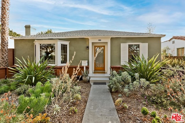 On one of the best tree-lined streets in Sunset Park is where you'll find this classic California bungalow with seamlessly mixed period features and contemporary updates. A colorful native plant garden welcomes you into the light-filled living space with original crown molding,  decorative fireplace, carved mantle and large bay window. From here enter in to the heart of this home - a thoughtfully updated cooks kitchen, where you'll enjoy entertaining with a custom walnut topped island, Thermador appliances, farmhouse sink, Caesarstone counters and eat-in dining area bathed in natural light. There are two bright and airy bedrooms and a fully remodeled modern bathroom complete with separate shower/tub and heated towel rack, allowing you to move right in. French doors lead right off the kitchen out to an expansive backyard which feels like your own private park, with multiple spaces for outdoor dining, relaxation and endless possibilities for expansion, a pool and to build an ADU. This peaceful and inviting house is perfectly located in close proximity to local parks, schools, weekend farmers market, shops and restaurants. You'll love where you live!