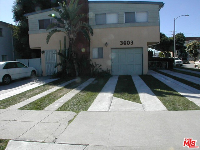Architecturally remodeled contemporary townhouse in Palms/Culver City with 2 private outdoor brick patios perfect for entertaining!! this 2 bd/1.5 bath unit features new kitchen with stainless appliances, hardwood floors, two x-large sunny bedrooms with great closet space. A coveted location a few blocks to new Expo-line accessible to Santa Monica and Downtown. Also easy access to freeway 10 and 405, minutes to Beverly Hills, Westwood, Culver City and Santa Monica. Side by side parking! Washer/dryer on premises. Steps to great shops, restaurants. A beautiful quiet tree lined street for your discriminating client!