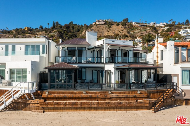 An extraordinary combination of architectural quality, style and character. This property is a rare find on Malibu's highly coveted La Costa Beach. Situated on an oversized 60' wide lot, boasting truly exceptional details and privacy rarely found in Malibu beach houses. The layout effortlessly adapts and accommodates anything from a quiet weekend with a loved one to a full house of family and friends. Private courtyard pool, separate cabana room/bar. Generous oceanfront decks with multiple outdoor living spaces. Grand living room with stunning views, fireplace, and lovely separate family room/den. The primary bedroom suite is a dream oceanfront retreat with fireplace and separate office/den. A truly exceptional and very special property.