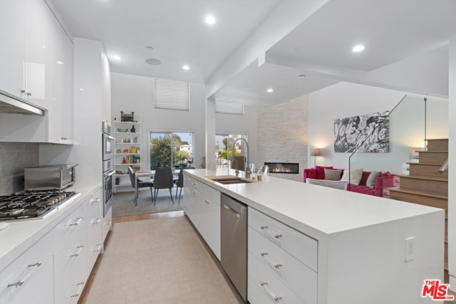 """What you need to know about this wonderful property: Once in a rare occasion, a truly remarkable home comes to market- luxury living at the beach. This is that home. Meticulously renovated in 2019 from top to bottom, everything inside has been reinvented, re-crafted, and renewed with this tri-level 2- bedroom 2.5 bath condo.  New kitchen with custom cabinets and custom breakfast nook with storage, new bathrooms including Toto toilets with bidets and tile floors, new 9"""" wide wood floors, custom built closets, LED ceiling lights, recessed baseboard molding and modernized sprinkler heads. Smart home integration including 60 smart switches, 6 zone Sonos speakers, smart doorbell, key less lock, alarm system and cameras throughout. Additional CAT 6 wiring on each floor for an ultra-high-speed network. Soaring 19 ceiling and custom-built glass staircase to the loft which hosts a media room with Dolby Digital surround system.  A 160-sf private patio with an outdoor movie screen and fire pit round out this luxurious condo. // What our sellers love most: The extensive remodel created an openness unlike other units. A luxurious oasis that is both comfortable and elegant. Very private and quiet tri-level condo; a stones throw to the beach and walking distance to exceptional dining. // This homes personality is: Open, yet inviting and ready to host a dinner party."""