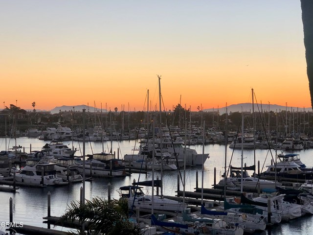 It's the View (and the value) you've been waiting for!  Beautiful unobstructed views of the marina, ocean and islands from this premium South-facing, top floor end unit facing the water. One of the best and rarest views in town!   Sit inside on your sofa, in your bedroom, in your kitchen or on your private deck and watch the boats sail by as the sun sets over the Channel Islands.   The building features an elevator, laundry on every floor, indoor parking with deeded space and storage area.    Resort living with 3 pools, private ''Marina Club'' that features indoor lounge, gym, saunas, outdoor spa, gas barbecues and lounge area, tennis courts + more. Prime Hollywood Beach location in the heart of the Channel Islands Harbor.  A brand-new Hyatt Hotel and Restaurant and new marina are scheduled next door adding to the allure of this special area. Located between Malibu and Santa Barbara, Channel Islands features a quiet, laid-back feel of a small coastal town. We have plenty of free parking, uncrowded sandy beaches and awe-inspiring sunsets. Miles of dog-friendly beaches and scenic paths start right at your doorstep. There is lots to do in the neighborhood from SUP and Kayaking, sailing, fishing, diving, surfing - even parasailing! Or you can simply relax on your living room sofa or patio and watch it all from your waterside home.