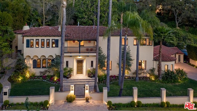 Featuring stately curb appeal in the flat section of coveted Tower Road just north of Sunset, this grand gated Spanish estate is infused with period details; but, updated for one's modern sensibilities. Sunlit rooms with high beamed ceilings, wood and tile floors, two upstairs balconies, French doors, authentic hardware, and stained glass. Dramatic 2sty entry foyer sets the tone. Massive living room with impressive fireplace and adjacent circular den/sun room. Gracious dining and breakfast rooms. Chef's center-isle kitchen combines with a huge comfortable family room for superb entertaining capacity. 4 generously-sized bedrooms upstairs (one is a large convertible library) and a quaint outdoor guest suite/gym. Separate powder room and a downstairs guest bathroom. Mammoth master suite with peek-a-boo city lights treetop views, office area, dual walk-ins, and inviting bathroom. Living, breakfast, and family rooms all open to glorious patios, lawns, and meditative hillside gardens. 3 car direct-entry garage for privacy and security along with great off-street parking. A Tesla Powerwall and vehicle charger are of added benefit to an already tremendous home of which one can be proud to call their own.