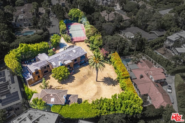 Rare opportunity to create a lavish Beverly Hills Estate, over 38,000sqft lot on prestigious Summit Drive. Existing tennis court and guest house. Shown only to prequalified Buyers.