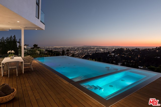 Magnificent new-built nestled in the exclusive Hollywood Hills community of Mount Olympus with staggering views and Designer finishes. This extraordinary 2 story modern home features a chef's kitchen with the latest high-end appliances, custom cabinetry and a spacious open living area with large sliding doors that open up to a resort-like patio and a zero edge infinity pool. The deck offers breathtaking panoramic views of the city and ocean. Exceptional details and quality are evident throughout this home's cohesive interplay of materials and technology. The second floor boasts the massive owner's suite and its luxurious bathroom, opening onto an expansive deck overlooking the city and the ocean. This dream house was built for indoor-outdoor entertainment. A must-see!
