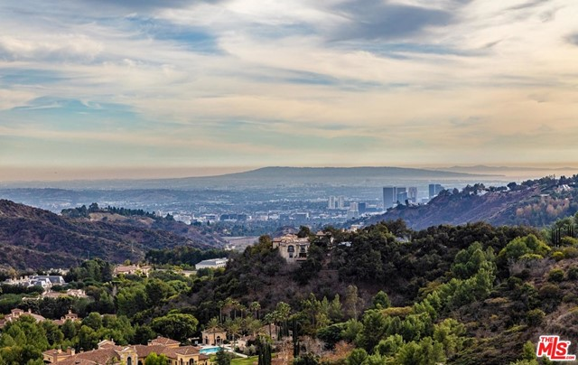 Prime development offering above Mulholland and overlooking Beverly Park with sweeping, unobstructed views from Beverly Hills to the ocean. Situated up a private driveway, this approximately 3/4 acre+ pinnacle property exhibits remarkable potential to build an unparalleled view estate in 90210.