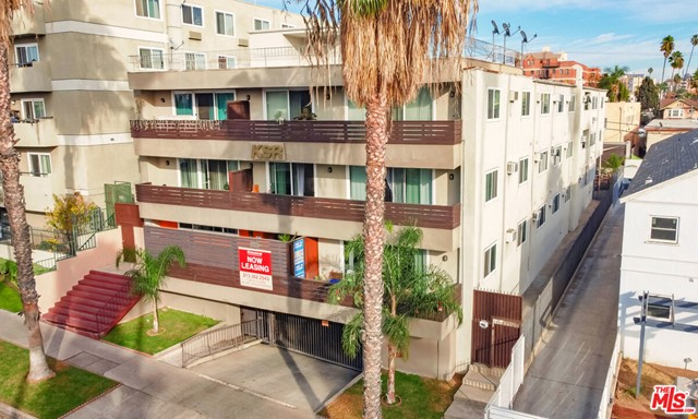 932 S Westmoreland Ave is a 32-unit, 3-story, value-add apartment building located in the highly desirable Mid-Wilshire submarket of Los Angeles. Constructed in 1964, the building has a unit mix of 12 bachelor, 5 single, 12 (1+1), and 3 (2+2) units averaging approx. 639 sqft, and 15 of the units (47%) have been upgraded over the years. The 20,445 sqft structure sits on a 10,700 sqft, LAR4-1 zoned lot. The roof was replaced in 2020, a new elevator was installed in 2019, new windows (building-wide) in 2018, and the parking garage features a new gate motor. The main entry, lobby, hallways, and common area lounge feature updated lighting. The rear yard common area includes a patio and elevated deck furnished with tables and chairs. The security system consists of 16 cameras and 4 Ring cameras placed throughout the property. Secured garage parking holds 27 spaces. The building is separately metered for electric, master metered for gas + contains a new master boiler.