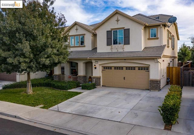 ROSE GARDEN BEAUTY!Nearly 2900 Sq Feet, 5 beds,3 full baths, w/One bed/bath downstairs,plus a Bonus Upstairs LOFT. Immaculate Kitchen w/SS appliances,Granite counter-tops,18x18 Tile Flooring, Walk in Pantry, Extended center Island w/Stunning Quartz Countertop and built in seating.Kitchen looks onto Expansive Family Room w/beautiful Laminate Hardwood Flooring.  Luxurious Owners Bed&Bath Suite,featuring double sinks,granite counter-tops, sunken tub, oversized shower,walk-in closet w/built in drawers & shelving.  Upstairs Laundry Room! Custom Paint, Upgraded flooring and elegant window coverings. Charming Upgraded French doors leading out to ENTERTAINERS DREAM BACKYARD,w/Attached Solid Patio Awning w/fans & lights,BBQ, Fire Pit w/built in seating, stamped concrete, low maintenance fully landscaped yard w/drought resistant artificial grass.Community amenities include a Gated Pool, picnic area, play-scape & Clubhouse. Close to great shopping, restaurants, trails, parks & High rated Schools!