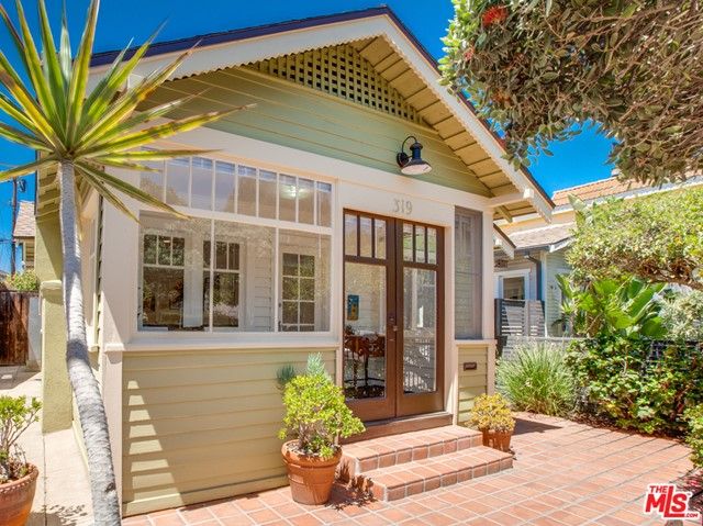 This fabulous home is the quintessential beach bungalow, situated on the pretty and charming third block of Windward Ave.  With close proximity to both Abbot Kinney Blvd and the Beach, the location is one of the best Venice has to offer.  This 2 bed / 1 bath home benefits from being recently remodeled, including brand new kitchen and bathroom, as well as refinished hardwood floors, painted throughout and a new roof.  This wonderful beach pad is filled with light and air and the kitchen and master bedroom benefit from high pitched ceilings, with skylights, both with french doors, that lead onto the tranquil and superb Yard/patio area.  This lovely courtyard area is both private and spacious, perfect for entertaining and relaxing.  The property further benefits from excellent 2 car parking and storage spaces, which include a private garage and separate car port area, as well as storage room.  This truly special beach bungalow has a happy, magical feel and is steps from all the best the Beach has to offer.