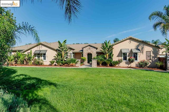 Amazing expansive single story at the end of a Court!!  PRIVATE BACKYARD!! Almost 3/4 acre lot!!!  Located on a cul de sac, this large home features a rare oversized backyard and an additional 2 large side yards.  With numerous palm trees, magnolias, citrus, and fruit tree as well as gated entry and gated side yard you'll find complete privacy.  4 large bedrooms each with its own bathroom, travertine and solid acacia hardwood floors throughout, 3 fireplaces, family room, great room, office, bonus room, and 4 car garage!! The master bedroom retreat is larger than most apartments with a French door opening to the Lanai!  The kitchen features Wolf & sub zero appliances, extra large granite entertainers island, pantry, and opens to the family room. HOME SCHOOLING?? Sonic internet is connected throughout the home providing up to 1000 Mbs internet!! Centrally located in Brentwood close to shopping & parks.  DON'T MISS THIS ONE!!! VERY RARE OFFERING!