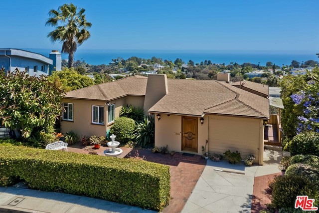 On the market for the first time in over 50 years, this panoramic ocean view property poses an incredible opportunity to remodel or build new. Entering on the top level, guests are welcomed by the mesmerizing views from the front door and nearly every room in the current home. The top-level features a living room, two bedrooms, a kitchen, and a dining room leading out to an impressive deck that seemingly floats out towards the ocean. A family room, bar, bedroom, and bathroom round out the lower level, leading to the lower deck with in-ground spa and yard. Just minutes from the Village, renowned beaches and trails, and the rest of the Westside, this is a rare opportunity to create a stunning dream home.
