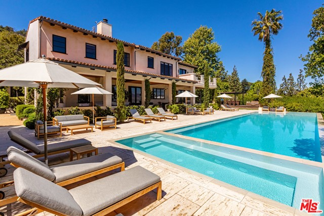 World Class Compound on 10+ acres. First time available in almost 20 years. Complete privacy, breathtaking views and sense of peace only minutes to the city. Built on what was once part of the Errol Flynn estate, this 13,530sqft Spanish Villa has always had an important Hollywood connection. Sited at the end of a cul-de-sac off Mulholland Drive, behind large gates and guard house, this is the ultimate hideaway. Recently renovated by renowned designer Estee Stanley, the interiors are a blend of modern and rustic elements. Youthful and fun, the main house offers an open floor plan, gourmet kitchen, gym, screening room, 7 bedrooms including a lavish primary suite. Epic outdoor living room wraps the house and provides the perfect backdrop for large scale entertaining. Grounds include guest house, 85ft long zero edge pool w/ plunge pool below, lit tennis court, meadow, forest, and farm-to-table vegetable gardens. A one of kind stately residence.