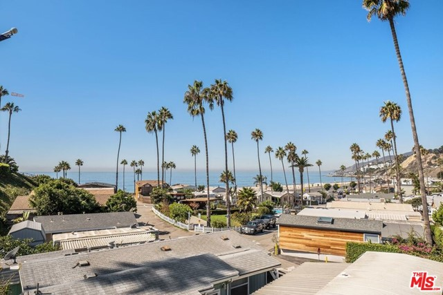 Live directly across from Will Rogers beach in a beautiful ocean-view 2 bed 2 bath beach bungalow. Steps from the sand and minutes from Sunset Surf Break, the Palisades Village and seemingly endless hiking trails. Enjoy in-unit laundry, two-car covered parking, a community pool and spa and shared recreational space. The 924SF+/- home offers Southern California coastal living with breathtaking sunsets and ocean views from the comfort of home and outdoor dining deck. Cross walk, for beach access. Nestled in a quiet community of beach-life enthusiasts. This home is a must see.