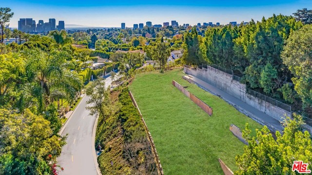 Fabulous View Lot on lower Tower Rd in prime Beverly Hills 90210. Prominently sited, this 1/2 acre lot is regally elevated above the street and captures sweeping Century City skyline views and tranquil treetop vistas. Apprx. 23,400sqft with 245ft of frontage and an expansive flat pad that's ideal for both owner/users or developers to design an architectural oasis!  Hard to find a wide 1/2 acre lot that's so beautifully sited! Surrounded by significant trophy estates this rare offering together with a premiere location just 3 mins from the BH Hotel and the center of the city is an amazing value and great investment for development. The seller removed all the overgrown trees from property and opened up an amazing view!  SELLER MAY CONSIDER CARRYING FINANCING, submit all offers. Survey and soil report available upon request. Please do not enter without agent present. Easy to show.