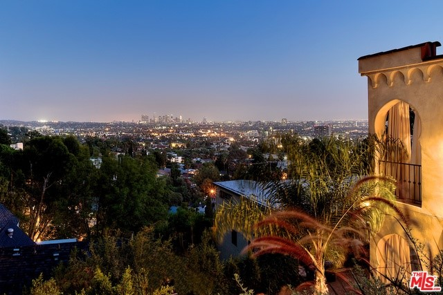 Enjoy Entertaining in this Beautiful Mediterranean Home offering the Best Views of Downtown Los Angeles. This Luxurious Property offers a Sense of Amazing Space, Flow, High Ceilings & Superior Craftsmanship. Three Glorious Open Living Areas offer Two Fireplaces. Wet Bar. Chefs Kitchen has a Huge Prep Island & Large Walk In Pantry. Wine Cellar for over 600 Bottles. An Atrium & Buddha completes this environment. The Master Bedroom offers Sanctuary, a fireplace & Huge en Suite Bathroom with Dual Sinks, Large Soaking Tub, Separate Shower & Large Custom Closet. All bedrooms are en Suite with Balconies & Jetliner views.  One bedroom has been converted to a large Custom Dressing Room w/ Mirrored Cabinetry, Shoe closet, Dressing Table & Bathroom with Shampoo Bowl. Office w/built Ins. Custom Media room. Park up to 4 vehicles. One Garage w/Powder Room & Ballet Bar. Make into a full gym for personal training sessions. Nice grassy yard, hot tub, Custom Fire pit w/seating area. Room for a pool too.