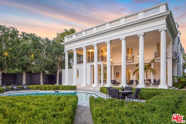Celebrated architect Wallace Neff's final residential triumph sited on the 9th fairway of Wilshire Country Club in Hancock Park. Timeless neoclassic design joins contemporary styling for a home originally created for the Chandler family of LA Times fortune & influence. The estates innate grandeur is meticulously preserved including original hand-carved crown moldings, imposing entrance columns with roof line balustrade complement, marble portico, awe-inspiring foyer w/ 30 ceilings and herringbone wood floors throughout. Imported door & window fixtures from Paris - as the mansion was inspired by Louis XVs Chateau de Louveciennes there. Recently installed new design elements echo Neff's original vision yet bring current technology & comforts to the forefront. Landscape design by Art Luna, gated motor court plus 7 car Garage, captivating views and boundless imagination support the experience of living in the capture of this rare residence.