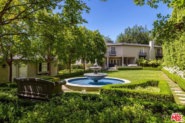 This beautiful private & serene French traditional is set on an almost half-acre lot. Sprawling with meticulous gardens & majestic water features this gem is located on one of the most desirable streets in the flats of Beverly Hills. Within walking distance to all the world class dining & entertainment Beverly Hills has to offer. Enter to a grand entry with hardwood floors and spiral staircase leading to an impeccably designed living room w/ fireplace, den & dining room. A luxurious chefs kitchen flows open to the covered al-fresco dining area perfect for your next dinner party. Complete with 4 guest suites and bonus maids room downstairs. This is the ultimate in sophistication & luxury; don't miss your chance to claim your spot on the most prestigious block in the world famous 90210 zip code.