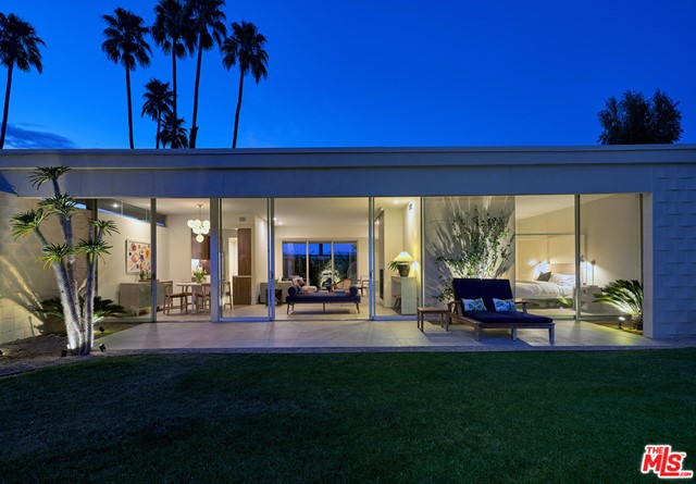 A stunning renovation of a mid-century classic at the sought after Seven Lakes Country Club. Originally designed by architect Richard Harrison in the late 60's, this recently renovated home boasts 10 foot tall floor-to-ceiling walls of glass, clerestory windows, a private patio & inspiring South facing mountain views. The home features new Italian porcelain floors throughout, gas burning fireplace, automated blinds in the living rm & an automated projection screen for movie nights. The chic kitchen features custom walnut cabinetry, quartz countertops, stainless KitchenAid appliances, wine fridge, farm sink & hand glazed tile backsplash. The smart range & faucet are both Alexa compatible. The large primary suite features walnut built-ins & a spa-like ensuite bath with Room & Board vanity. Additional features of the home include a new tankless water heater, washer/dryer inside, generous closet space & a single carport. There is also ample guest parking & easy pool access. Seven Lakes is a private golf community located by the Parker Hotel in South Palm Springs. With 24/7 gate guarded entry, amenities include a Ted Robinson designed 18 hole golf course, pro lessons, practice putting greens, 15 pools/spas (most with cabanas & grills), tennis court, William Cody designed clubhouse w/ dining rm, lively bar/lounge & outside terrace patio & mature landscaping.
