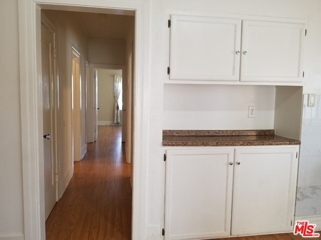 The normal price of the unit is $2500, however for the 1st year Only. Beautiful Upper and Spacious Two Bedroom and 1 1/2 Bath Townhouse in a Small Building, Hard Floors Throughout with Lots of Windows and Natural Light! Living Room with Bookcase and Large Windows Kitchen has White Cabinetry, White Quartz Countertops, Double Basin Stainless Steel Sink, Refrigerator, Dishwasher, and Gas Stove. Wall A/C Unit, Pretty Street View.