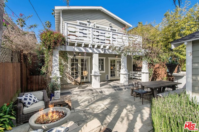 Beautifully reimagined California craftsman home built in 2001. This private and gated magical gem offers 3 bedrooms, 2 baths plus office/fitness/creative/4th bedroom flex space, holding true to authentic period design details while seamlessly integrating all modern conveniences. Features include Miele, Sub Zero, c.1955 O'Keefe Merritt stove, Carrara marble countertops, 2 fireplaces, wainscoting, period-style built-ins, home audio system, central air. The entire second floor reveals the fabulous and romantic primary bedroom suite with vaulted wood ceiling, fireplace, lounge deck, a generous walk-in closet and spacious bathroom with claw foot tub and separate shower. Relax or play in your private and dreamy back yard complete with a large stone patio, built-in barbeque and fire pit. Fully finished and climate-controlled 2-car detached garage plus extra parking. Highly desirable location on one of the estate streets of Venice and ideally located just two blocks from famed Abbot Kinney Blvd, restaurants, shopping. Walk/bike to the beach and the beautiful Pacific Ocean!