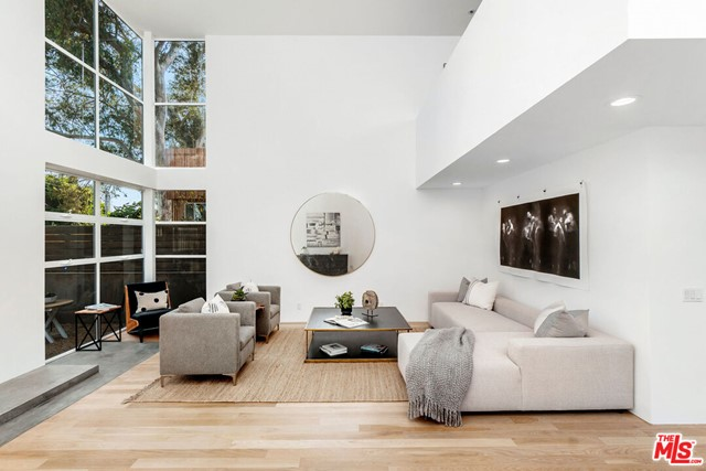 PRICE REDUCED to $2,975,000. Volume, privacy, versatility, this property is a fabulous turn-key home or investment with plenty of add-value opportunity for a discerning buyer. You wont find this size and quality anywhere on the market. Come live the ideal Venice Beach life!  Located in the famous Abbot Kinney district on arguably the best street in Venice steps from shopping, famous restaurants & white sand beaches. Expansive living/dining area w/ 22' high ceilings adorned w/ windows and 2 inviting outdoor retreats. Dramatic yet warm and inviting master suite w/ large windows, 180 treetop views, new marble bthrm, walk-in closet, fireplace and large private balcony. Second en-suite master and 2 other bedrooms all w/ private balconies for family and guests. All bathrooms are just fully renovated, breezy loft space, huge 2 car garage w/ 3rd bonus spot & the updated kitchen enjoys a Viking stove. This architectural hideaway is ready to sell. ALSO FOR LEASE $ $13,995 PER MONTH! Enjoy living in the heart of Venice Beach.