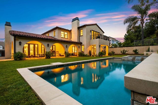 """Stunning sophisticated Spanish, in the exclusive Palisades Highlands. Located on a quiet cul-de-sac, this five bed, six bath spacious 5,444 sqft beauty sits on a generous 15,015 SF lot. Light filled interiors, high ceilings and indoor-outdoor flow create a welcoming ambience, and California living at its finest. An interior courtyard with fireplace and fully pocketing sliding doors adds to the home's warmth and further enhances the interior to exterior flow. All public rooms open to a generous backyard boasting a covered loggia, grassy yard, pool and spa. HOA includes 24hr security patrol and membership in the Palisades Hills rec-center with pool, spa and tennis courts, as well as access to the dog-friendly, private and gated """"Highlands Park"""". This property represents a unique opportunity for the most discerning buyer to enjoy a home perfect for both family and entertaining."""