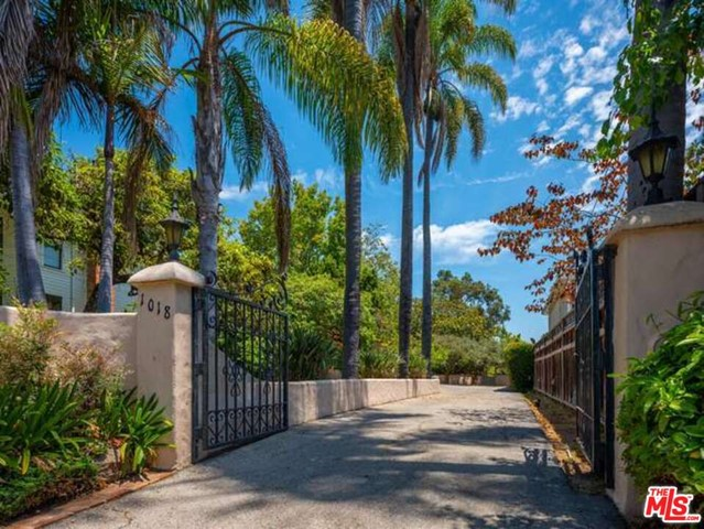 Exceptional Development / Building Opportunity in the heart of Pacific Palisades.  This large lot located on the prestigious Chautauqua Rim is an Oasis with park like grounds.  There are mature Palms, fruit trees and beautiful views.  This is wonderful location for a building project within easy access to the Palisades Village, the Caruso project, restaurants, shops, library, park hiking and biking trails, Will Rogers, the beach and all this wonderful area has to offer.  The current house and garage structures were built in 1931.