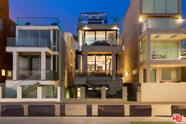 Quintessential California beach house on the sand in the heart of Santa Monica's historic Gold Coast. Warm, casual, inviting, whimsical, yet contemporary environment with clean lines, open floor plan, sun-filled spaces and floor to ceiling windows that take advantage of views that span from the Santa Monica Pier all the way to Point Dume in Malibu. Main level includes open cook's kitchen, dining and living room with high ceilings- all of which overlook the ocean and open to a covered private veranda, plus cozy media room/den with fireplace. There are 5 bedrooms and 4 1/2 baths, including a fabulous ocean front primary suite with terrace, marble bath and fitted closet. Other spaces and amenities include a fantastic top floor sunroom/gym that opens to a large roof terrace with spectacular views up and down the coast, a lower level guest room that opens to a private beach side patio, elevator, beautiful finishes & detailing and two-car direct access garage plus three car off street parking. A rare opportunity to live in a happy, exciting and chic home on a wide, sandy, quiet stretch of beach and enjoy beautiful Sunsets - all in close proximity to the Santa Monica pier and all the shops/restaurants on Ocean Avenue & the Third Street Promenade. The ideal California lifestyle!
