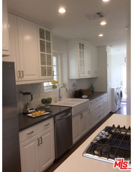 Laundry room at e end of e kitchen