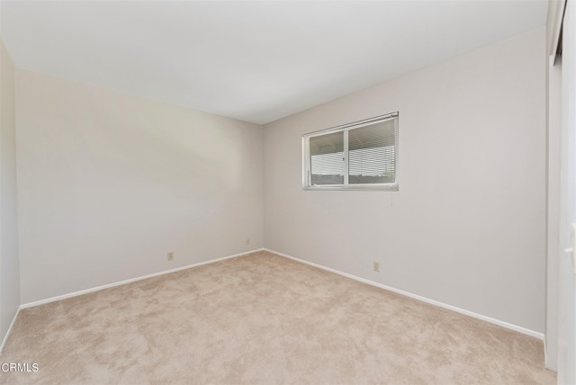 Carpeted secondary bedroom