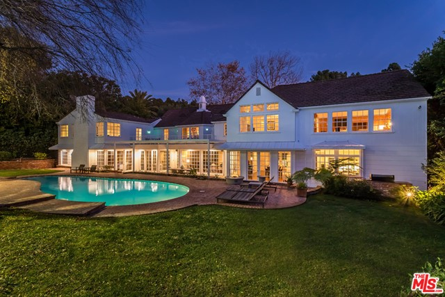 This beautiful, Traditional Tennis Court Estate with tranquil backyard is located in the heart of Beverly Hills. The circular driveway leads to a 2-story entry with a grand staircase. The home's spacious living room opens to the formal dining room and an inviting backyard with a pool and tennis court. A large family room with bar and fireplace, gorgeous kitchen, master suite with his and hers baths and closets, office, 3 additional bedrooms, staff's room and a bonus room make this the most comfortable home for sharing with the family, hosting and entertaining. A unique opportunity to own a property in prime Beverly Hills, north of Sunset and minutes away from Rodeo Drive and award winning hotels and restaurants. This gorgeous property with over 29,900 square feet of land is in the most sought after and desirable of locations.