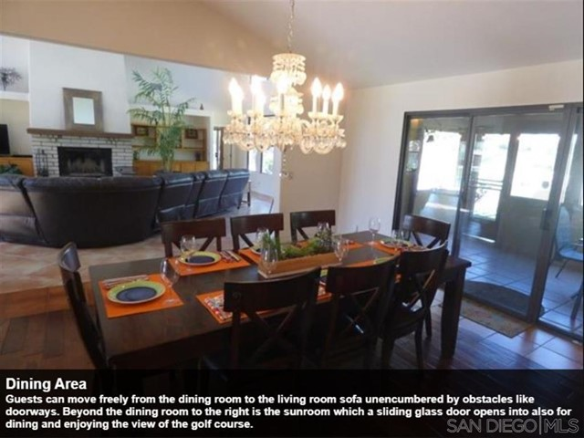 Guests can move freely from the dining room to the living room sofa unencumbered by obstacles like doorways. Beyond the dining room to the right is the sunroom which a sliding glass door opens into also for dining and enjoying the view of the golf course.