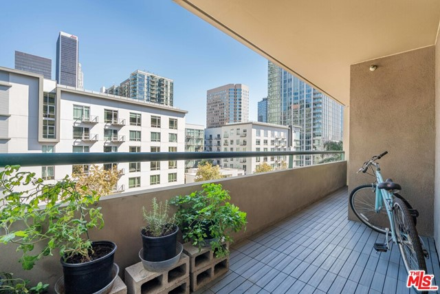 Welcome home to this 7th floor 2 bedroom/2 bath condo in a full service building, The Skyline, in the heart of downtown LA. This end unit gets great light and has beautiful hardwood floors and a balcony off of both the living room and the first bedroom. Balcony faces 9th St. Spacious master suite with storage galore. Full bathroom for guests and 2nd bedroom located off of the main hallway. This unit comes with 2 secure parking spaces! Amenities include a concierge, pool, gym, sauna, locker room, racquetball courts, and a clubhouse to name a few. Located across the street from Ralphs Fresh Fare and right next to the Fashion Institute (FIDM) and Grand Hope Park. Short walk to Whole Foods, LA Live complex, etc. Too many bars, restaurants, and shops to list.