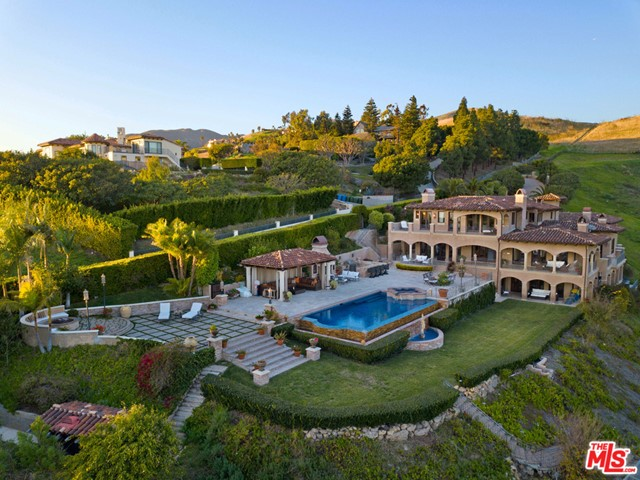 Live the perfect Southern California dream at this exclusive Malibu estate. This incredible 8,868 sf 3-story home sits on approximately 3.5 acres with expansive ocean views, private location and with resort-style grounds that will make you never want to leave your home. Behind the large private gates and down a long driveway awaits a 6 bedroom and 8 bathroom custom built Tuscan home with formal entry, formal living and dining room, and an open concept kitchen area.  Completed in 2006, this home was built with great attention to detail with fine imported Italian travertine flooring, rare granite and onyx stone countertops and hand crafted custom cabinetry throughout.  There is ample room for entertaining in the state of the art home theatre, billiards and bar area, wine cellar as well as over 2000 sf of attached deck space and an infinity edge pool with spa.