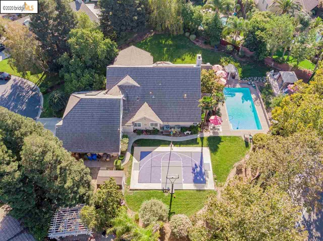 Own One of The Best Homes in Brentwood... Situated on 1/2 Acre - This 5000 sf Custom Home in the Highly Sought After Pheasant Run Estates Has Everything You Wish For.... The Resort Like Grounds are Simply Breathtaking...An Entertainers Dream Home.. The 40 ft Swimming Pool, Sport Tech Basketball Court, Huge Grass Area, Gorgeous Trees Surrounding the Home, Very Private Setting, Huge Storage/Tool Shed, Built in BBQ Island....and There is More... Inside it Gets Even Better - A Chefs Kitchen, Spacious Family Room w/ An Oversized Fireplace, Downstairs Master Bedroom Suite, In Law Room w/ Separate Entrance, A Real Home Theater w/ Built in Cinema Seating, A Huge Bonus Room Upstairs for Anything You Can Dream Of, Spacious Bedrooms, A Utility Room w/ Full Bath can be Accessed from the Backyard - Perfect for Pools Days & Guests-Solar Panel System is OWNED!!! & There is Much More...You Have to See For Yourself Why This is One of the Best Family Homes in Brentwood Go Visit www.1815pheasantrun.com