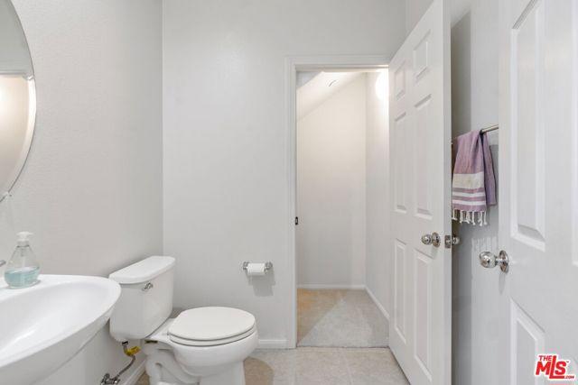 Powder room w/ closet under stairs