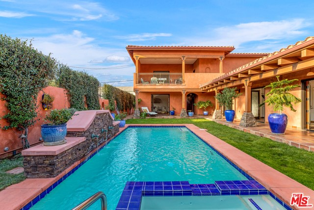 Major price adjustment! Bespoke Spanish villa on coveted 10,000+ sq ft lot in East Venice. Noteworthy features include an auto turntable for front-facing driveway exit, a Tesla EV charger, handmade Mexican terra cotta floor tiles and Talavera accent tiles, elevator access to the main suite, heated floors throughout, an entertaining cabana off the heated pool/spa, enormous ceilings, clerestory and picture windows to bring in ample natural light, plus multiple indoor/outdoor access points to take advantage of our beautiful climate. Kitchen was just updated in August 2021 by opening up the wall between the cooking area to allow for an eat-in counter. Mature citrus trees in front and lush landscaping enhance the resort-like feeling throughout the property. Conveniently located just minutes from Erewhon, Whole Foods, Venice Beach, the 10 freeway, Superba, Deus Ex Machina, and more - this property epitomizes California living. Priced to sell - owner is ready for offers!