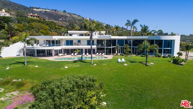"""Perhaps the best white water and coastline ocean view estate in all of Malibu Park. Nearly 12,000 SF on 3.48 acres, Contemporary design and jaw-dropping vistas highlight this property, featured in countless major motion picture and television shows including; The Assassination of Gianni Versace, Blow, Like Mike and Ray Donovan. Panoramic Whitewater ocean views exhibit what Malibu has to offer, overlooking world famous Zuma Beach, extenuated by 20-foot tall ceiling to floor glass windows that showcase some of the most incredible sunset views seen in California. Walk out the 200+ guest party room to a private 70-foot long pool and spa add to this atmosphere while hearing the waves crash upon the Zuma Beach sand. This estate also boasts a 2,000 SF 2 bed, 2 bath guest house for family and extended stay company. This estate is truly one-of-a-kind in it's stature, size, and """"wow factor"""" while its privacy and ocean views and location are unparalleled, surrounded by multiple $10m+ estates."""